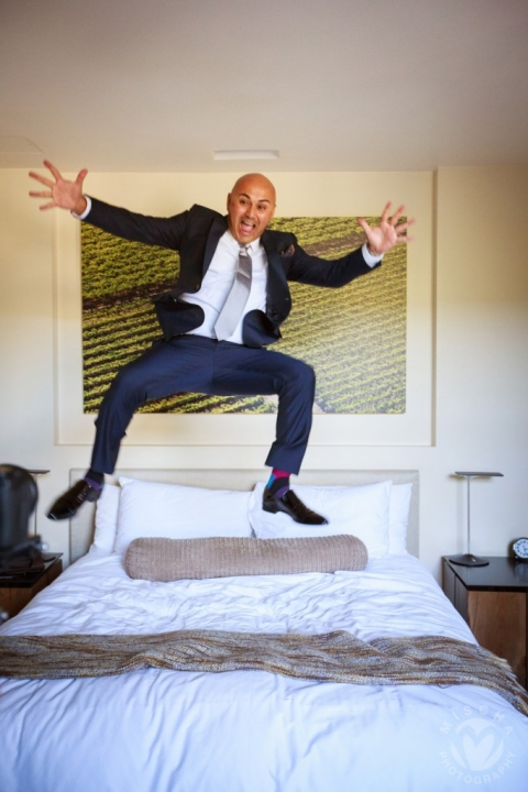 groom jumping on the bed